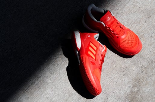 a2480c873f0 The choice of footwear for Andrea Petkovic during the US Open, while  Caroline Wozniacki will wear the Stella McCartney Barricade BOOST in the  striking solar ...